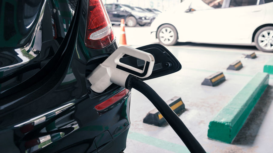 Fuel pump refueling car at gas station