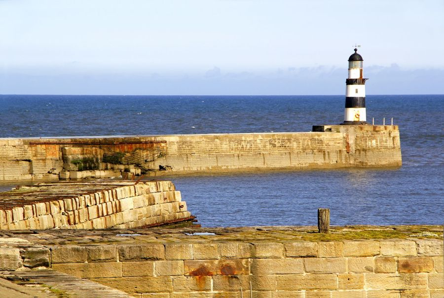 The old lighthouse built in 1905 on the north pier at Seaham Harbour in County Durham England Architecture Beauty In Nature Breakwater Building Exterior Built Structure Day Direction Guidance Harbor Harbour History Horizon Over Water Lighthouse Nature No People Outdoors Pier Protection Safety Scenics Sea Sea Wall Sky Tower Travel Destinations