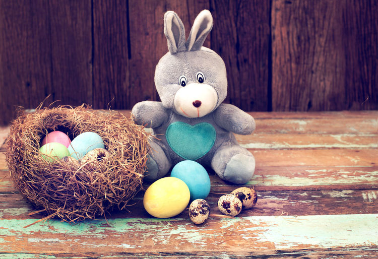 Vintage Easter eggs colorful with bunny doll on wood table, instagram filter Celebration Easter Holiday Easter Bunny Animal Representation Egg Representation Easter Egg Holiday - Event Decoration No People Wood - Material Rabbit - Animal Art And Craft Stuffed Toy Food Animal Group Of Objects Eggs Easter Egg Vintage