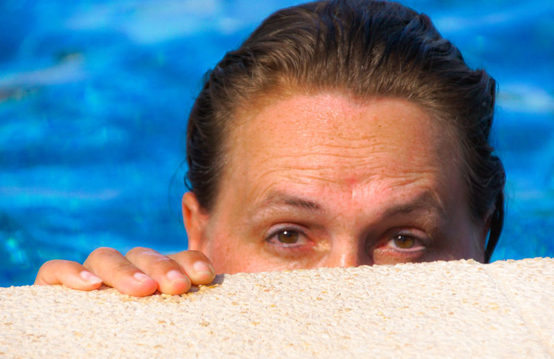 Cropped image of mature woman against swimming pool