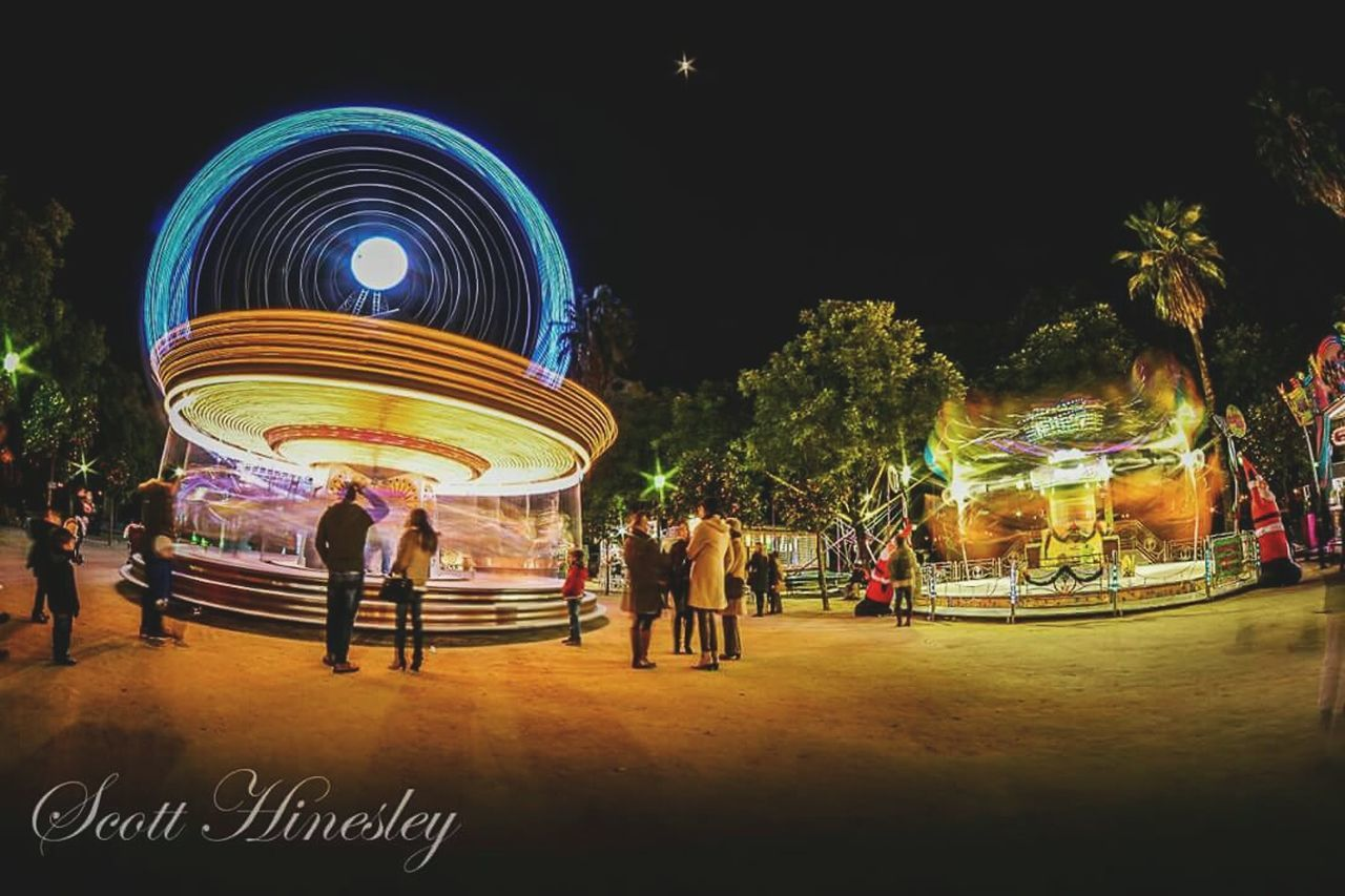 leisure activity, arts culture and entertainment, illuminated, real people, amusement park, enjoyment, night, outdoors, large group of people, men, lifestyles, clear sky, nature, sky, people