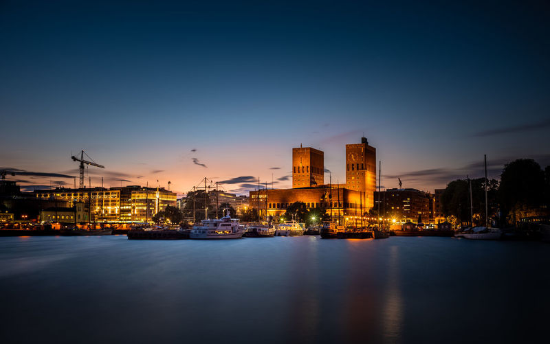 Oslo City Hall after sunset. EyeEmNewHere Oslo City Hall Hall Norway Oslo Long Exposure Office Building Exterior Cityscape Outdoors Sunset No People Reflection Building Waterfront Night Water City Illuminated Built Structure Sky Architecture Building Exterior Twilight Evening