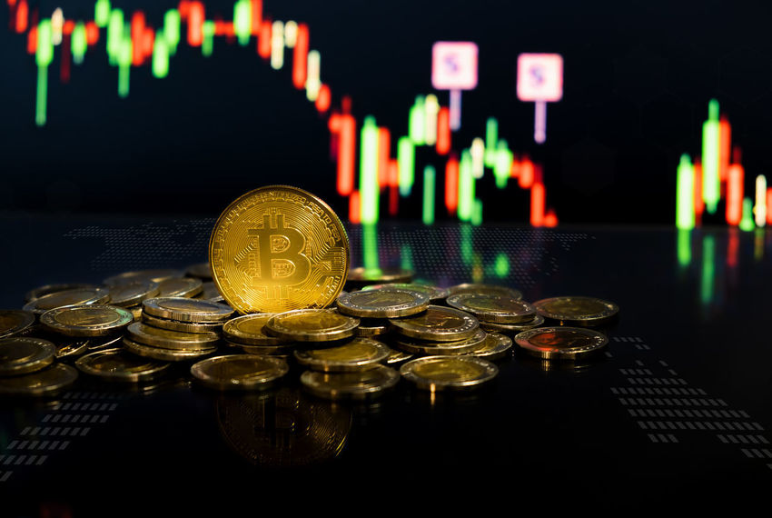 Gold bitcoin on coin money with candle stick graph chart on background Currency Finances Gold Growth Market Sign Bit  Bitcoin Blockchain Technology Business Buy Cash Chart Coin Coins Cryptocurrency Digital Exchange Finance Graph Investment Money Payment Stock Trade