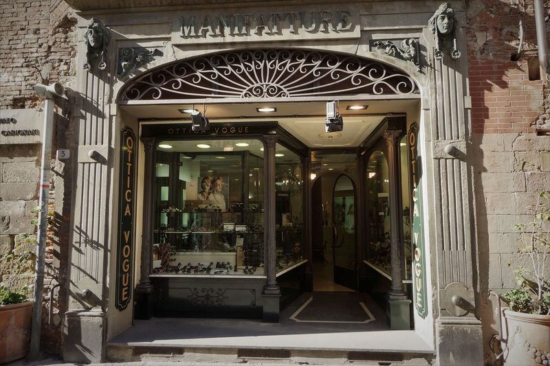 Shop Window Architectural Feature Art Deco Style Built Structure Day Jugendstil Narrow Street No People Old Town Toscana Touristic Destination Wall Face