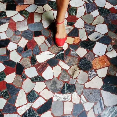 Low section of woman on cobblestone