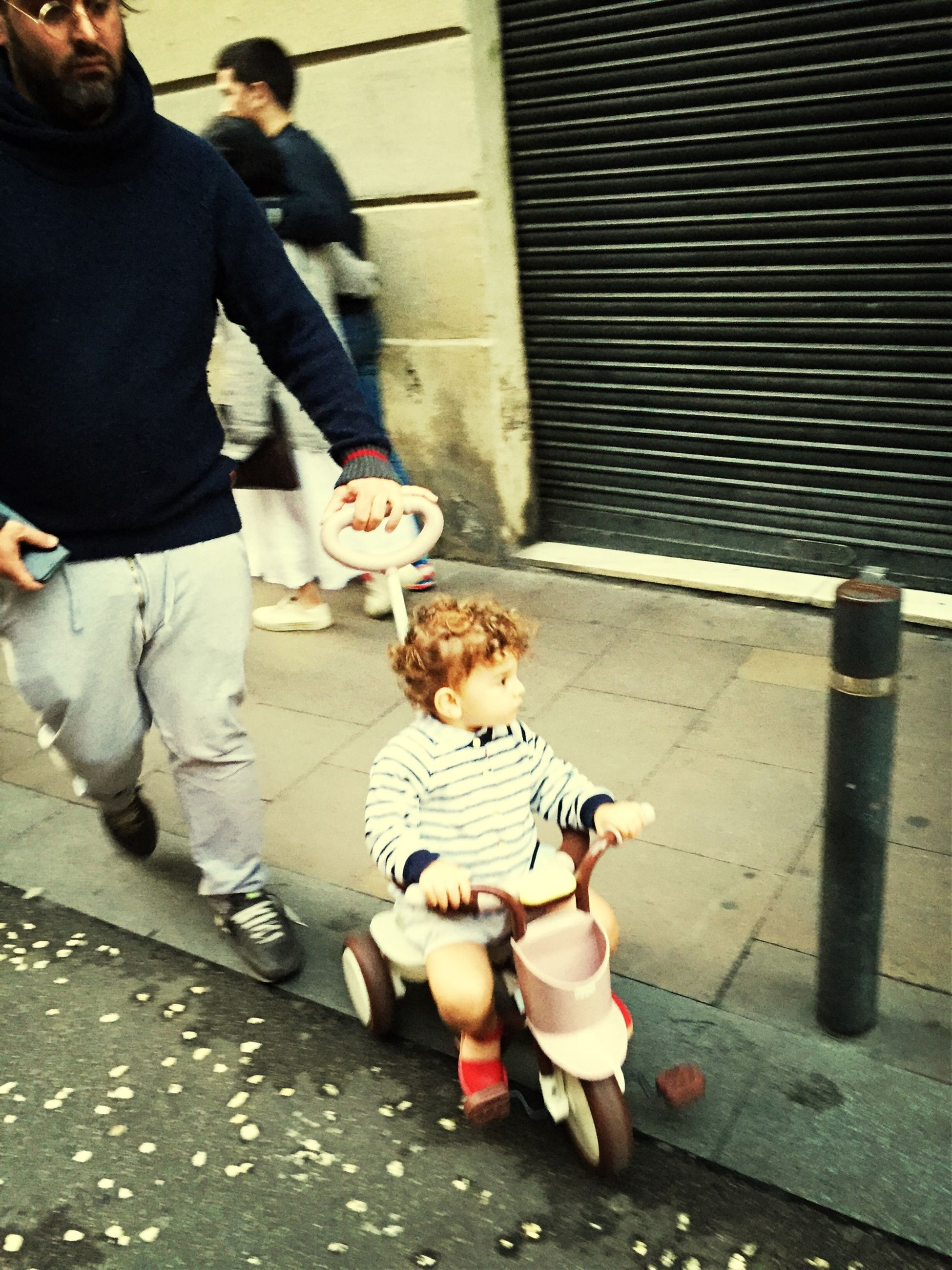lifestyles, casual clothing, street, leisure activity, full length, togetherness, men, holding, childhood, animal themes, person, sitting, standing, walking, food and drink, boys, elementary age