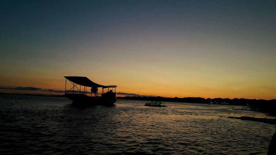 sunset 🌅 No Filter River Sunset Water Boat Water Vehicle Calm A New Beginning
