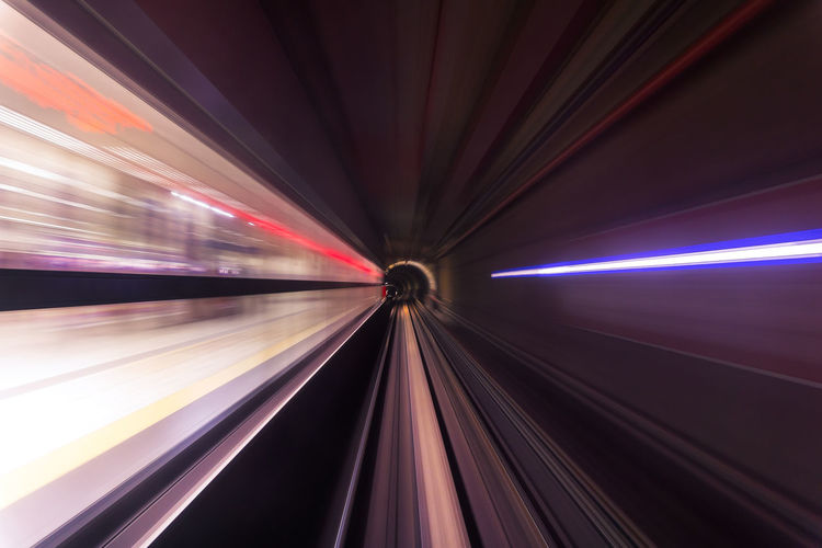 An image from a time lapse sequence taken in a subway train at night as the train leaves one of the stations. Blurred Motion City Futuristic Illuminated Light Effect Long Exposure Motion Moving Walkway  Night No People Outdoors Speed Technology The Way Forward Transportation Tunnel