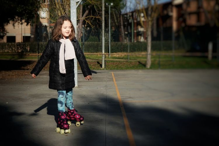 Full length of girl roller skating at park