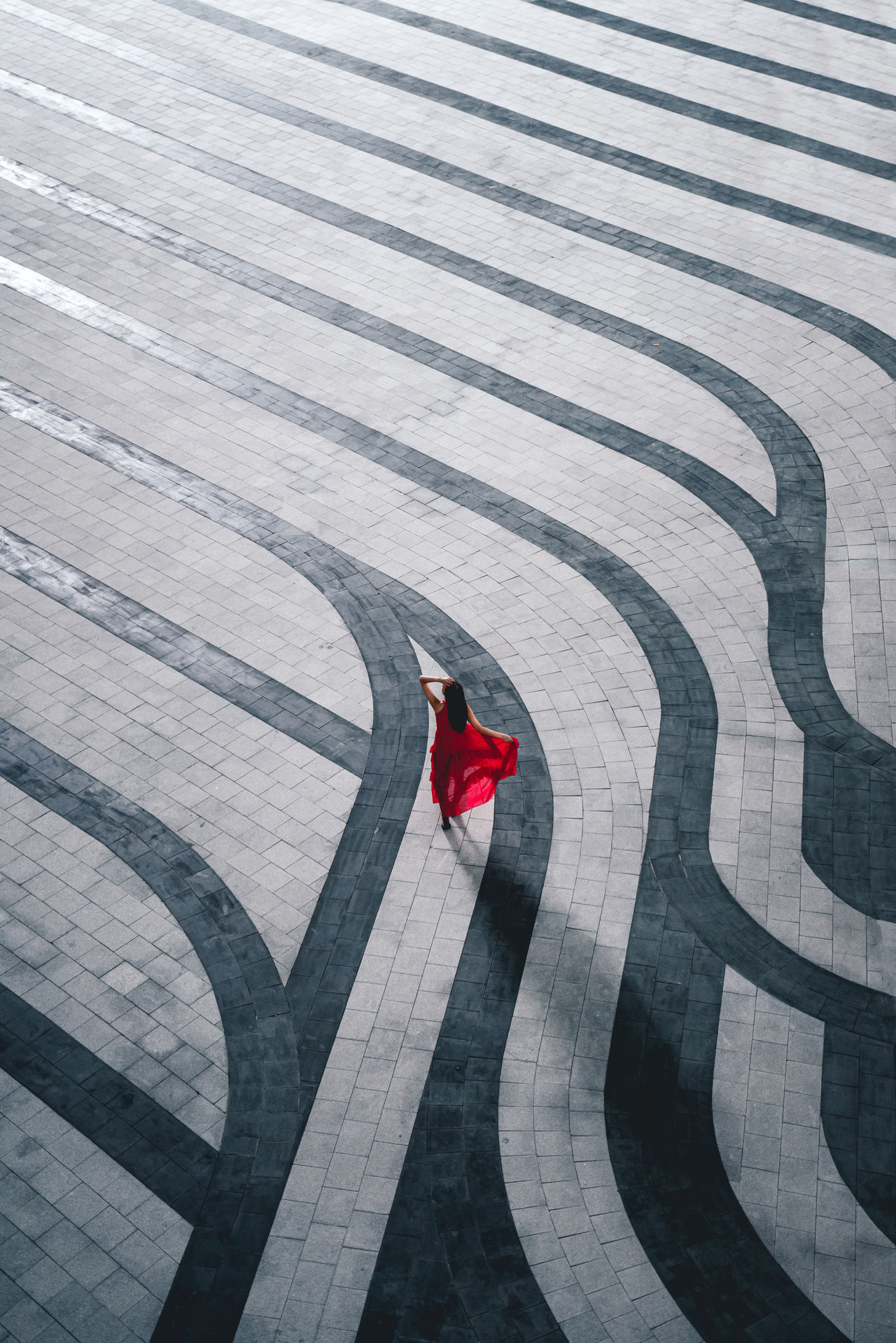 High angle view of woman standing on footpath