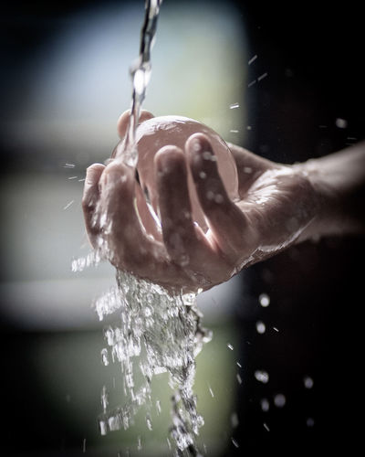 Close-up of person hand in water