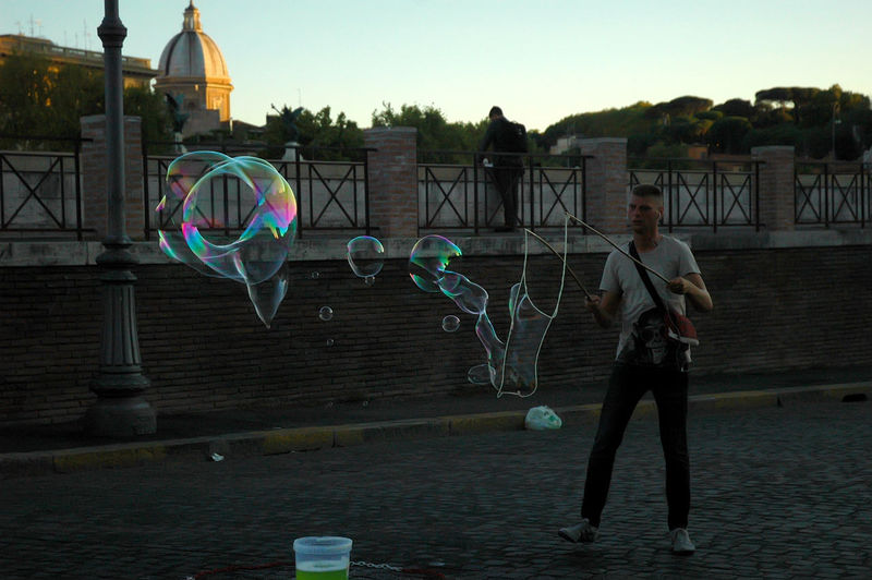 Blowing Bubble Happiness Leisure Activity Lifestyles One Person Outdoors People Playing Rainbow Real People