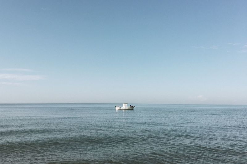 Lonely boat Sea Nautical Vessel Mode Of Transportation Scenics - Nature Horizon Beauty In Nature Ship Tranquil Scene Tranquility Blue Nature Sailboat No People Day
