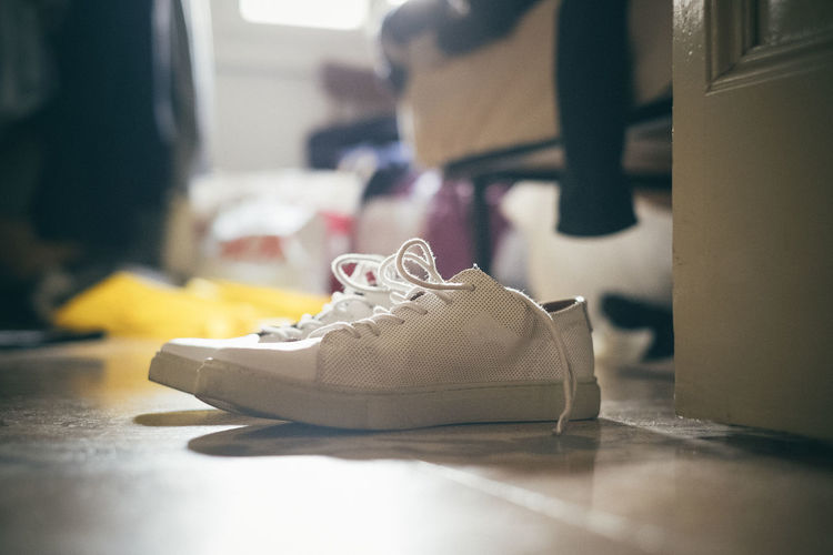 Close-Up Of Canvas Shoes On Floor