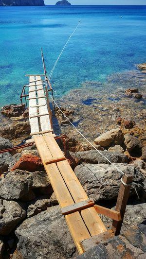 Narrow Footbridge At Calm Blue Sea