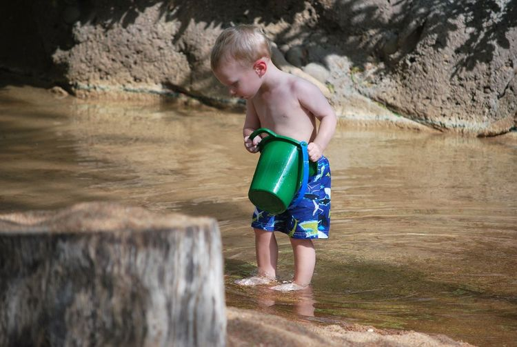 Boy playing in water
