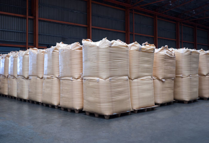 Stacking of bulk cargo in jumbo bags are store in warehouse. BIG Flooring Jumbo Logistics Rice Sugar Bag Bulk Cargo Chemical Export Flour Group Of Objects Handling Import Indoors  Industry Large Group Of Objects Mound No People Pallet Paper Stack Tapioca Warehouse