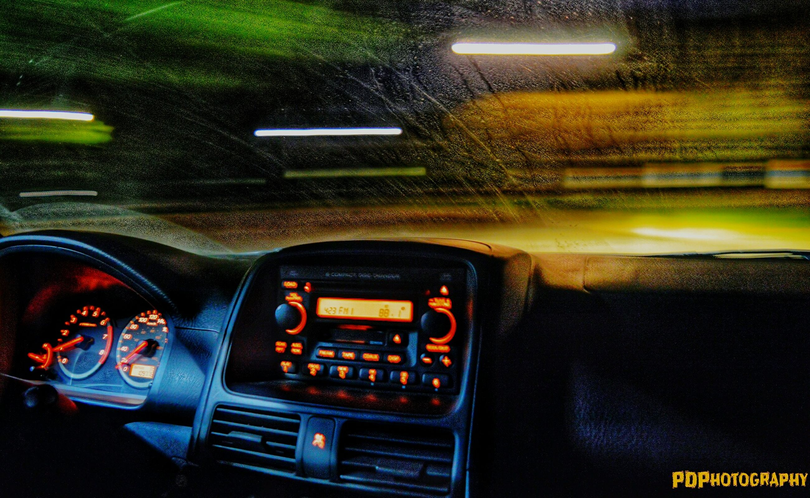 transportation, land vehicle, car, mode of transport, illuminated, night, car interior, vehicle interior, road, windshield, travel, street, dashboard, communication, headlight, close-up, glass - material, no people, technology, part of