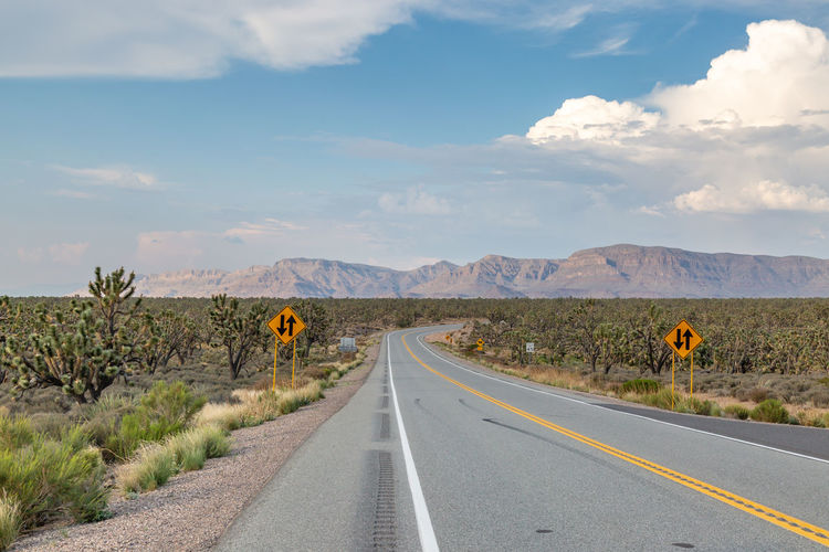 A road in arizona leading to the grand canyon