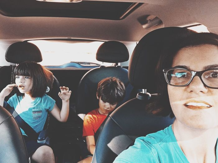 The Week On EyeEm family car rides Vehicle Interior Car Car Interior Real People Transportation Land Vehicle Sitting Mode Of Transport Casual Clothing Boys Togetherness Day Mobile Phone Eyeglasses  Girls Headphones Technology Wireless Technology Lifestyles Headshot