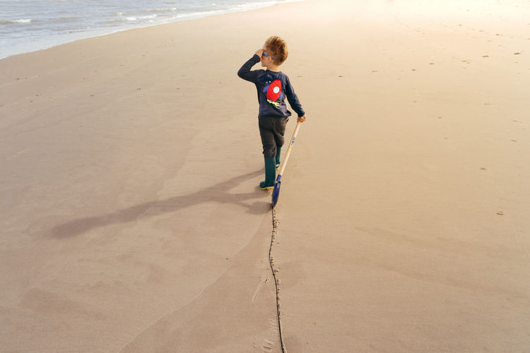 Tracking Beach Casual Clothing Childhood Day Full Length Innocence Outdoors Person San Sand Sea Shadow Shore Summer Sunlight Sunny Tourism Track Track Life Vacations Water Weekend Activities