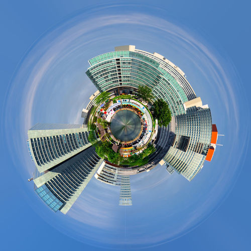 Little planet format of city and sky