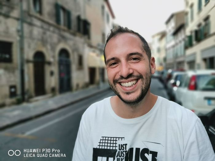 Portrait of smiling man in city
