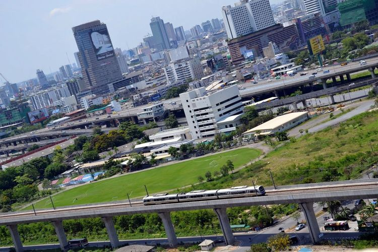 Bangkok's Skytrain on the line to Suvarnabhumi Airport (BKK) Architecture Bangkok Bridge - Man Made Structure Building Exterior Built Structure City Cityscape Day Modern No People Outdoors Road Sky Skyscraper Skytrain Skytrain Bridge Skytrain BTS Skytrain Tracks, Airport Suvarnabhumi Airport Suvarnabhumi Airport Rail Link Thailand Tree
