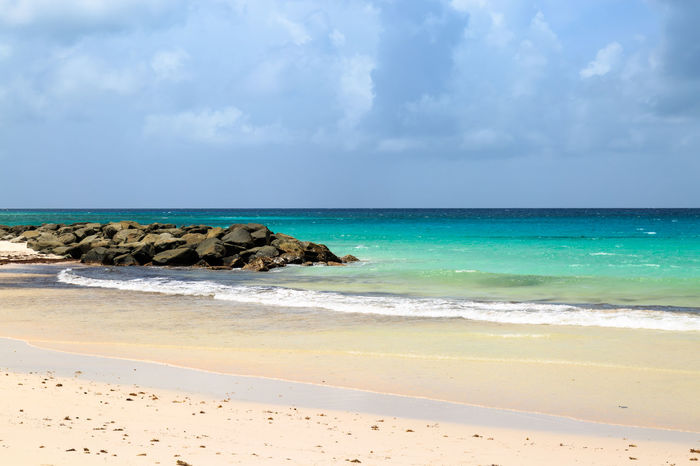 Caribbean Beach Barbados Beach Beauty In Nature Caribbean Caribbean Sea Cloud - Sky Day Holidays Horizon Over Water Nature No People Outdoors Sand Scenics Sea Shore Sky Tourism Tranquil Scene Tranquility Travel Travel Destinations Vacations Water Wave