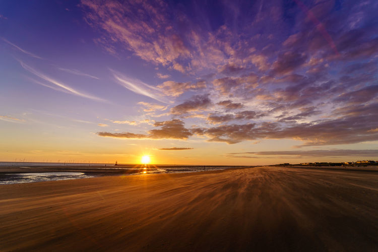 The evening sun sets down as the wind chases sands on Crosby Beach, Waterloo. Blue Hour Crosby Beach Liverpool, England Sunset_collection Waterloo Cloud - Sky Landscape Nature No People Outdoors Sky Summer Sun Sunset Tranquil Scene Tranquility