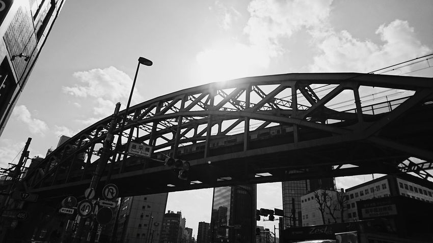 Bridge - Man Made Structure Built Structure Sky Low Angle View Blackandwhiteonly Blackandwhitephoto Blackandwhitepics Blackandwhitephotos Black And White Collection  Blackandwhite Photography Monochrome World Blackandwhite Silhouette Skyscraper Dramatic Sky City Life Cityscape Architecture Travel Cloud - Sky Travel Destinations City Outdoors Day