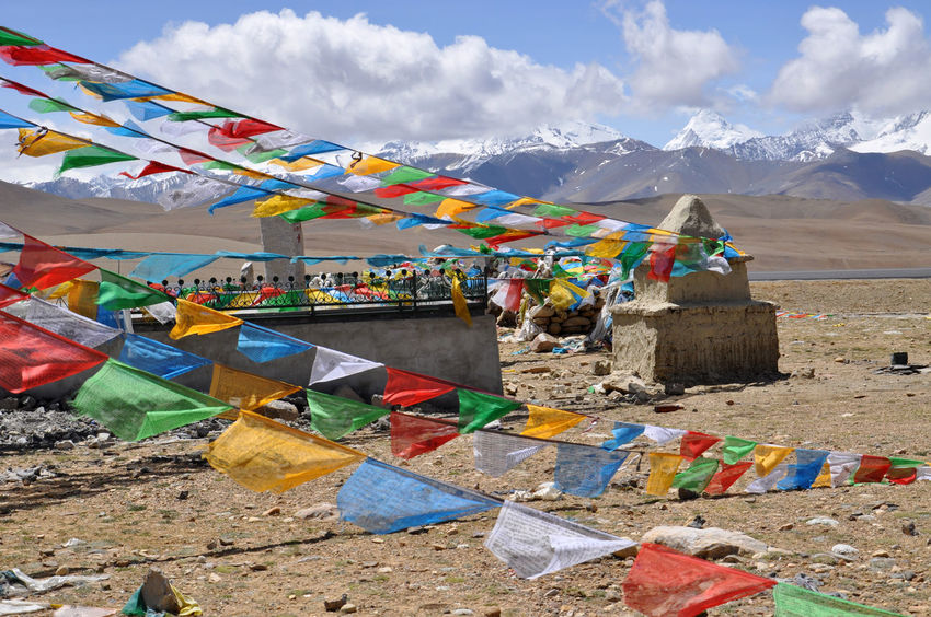 buddhist prayers flags in Tibet Blackandwhite Bright Buddhism Color Colorful Day Faith Flags Green Mountain Multi Colored Outdoors Prayer Flags  Relaxing Religion Sky Symmetry Tibet Tibetan  Tibetan Buddhism Travel Travel Destinations Travel Photography Yellow