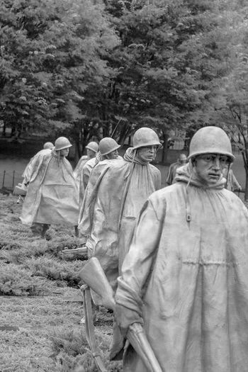 Statues of Soldiers at US National Korean War Monument Black & White Military Art Representation Statues Day Men Tree People Clothing Nature Adult Plant Group Of People Outdoors Land Walking