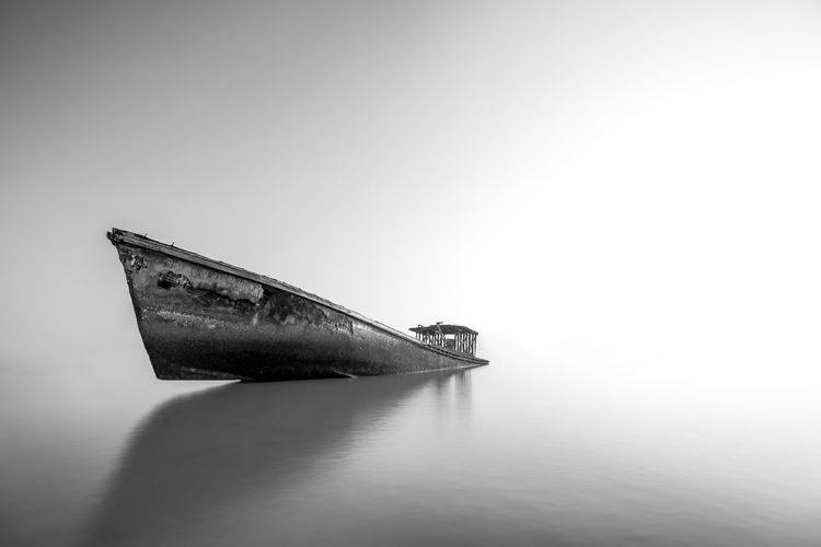 Nautical Vessel Mode Of Transportation Transportation Water No People Single Object Sea Copy Space Ship Waterfront Damaged Abandoned Studio Shot Obsolete Sinking Shipwreck Nature Day Old Economy