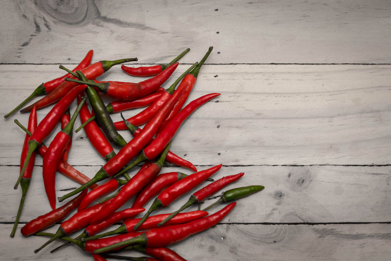 Close-up Day Food Food And Drink Freshness Green Chili Pepper Green Color Healthy Eating High Angle View Indoors  Ingredient No People Red Spice Table Vegetable