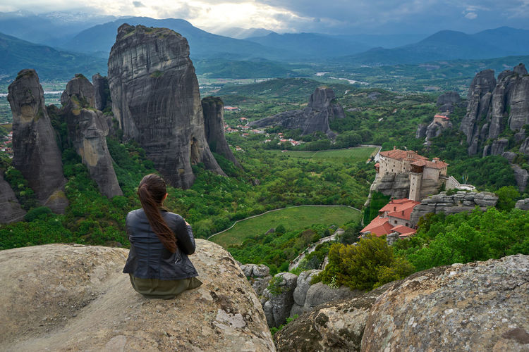 Beauty In Nature EyeEmNewHere Greece Landscape Looking At View Meteora Mountain Natura Nature Nature Beauty Physical Geography Real People Rock - Object Rock Formation Rocky Mountains Scenics Sitting Sunset Woman