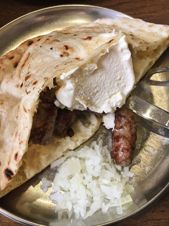 Traditional Bosnian meal Cevapcici with kajmak cheese Bosnian  Bread Cevapcici Cevapi Cheese Cuisine Dish Food Food And Drink Freshness Grill Grilled Kajmak Kebab Lunch Meat Minced Onion Plate Portion Ready-to-eat Somun Traditional