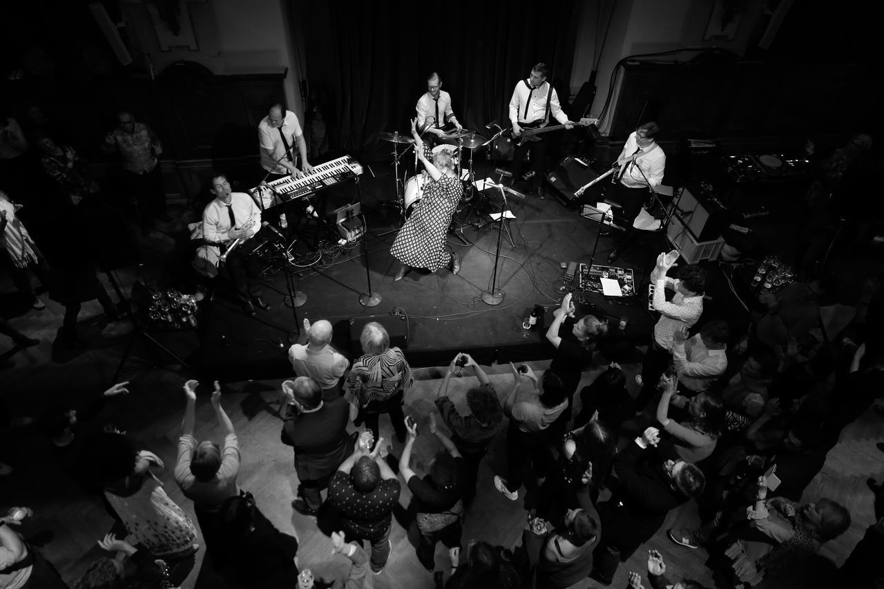 group of people, real people, crowd, men, music, women, large group of people, arts culture and entertainment, adult, musician, high angle view, performance, musical instrument, night, lifestyles, artist, indoors, leisure activity, group