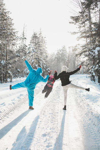 Crazy family of three on a winter day. Parents dressed up as animals Crazy Friends Family Fun Funny Snow ❄ Animals Arms Outstretched Arms Raised Cheeky Cold Temperature Crazy Crazy Family From The Back Full Length Goofy Leisure Activity Outdoors Real People Snow Togetherness Winter Winter Wonderland