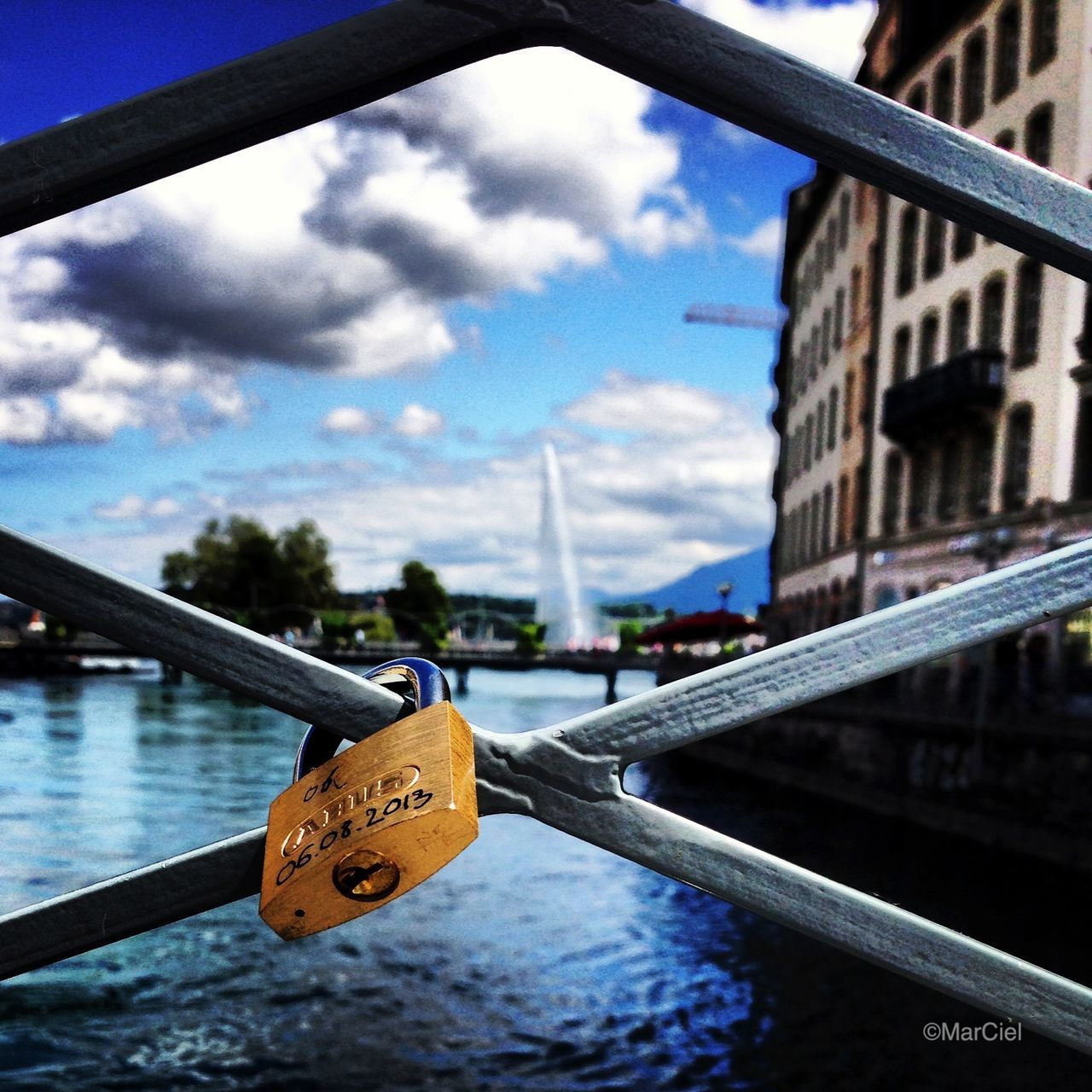 padlock, love lock, lock, water, security, safety, river, protection, railing, love, metal, bridge - man made structure, text, day, sky, hanging, close-up, focus on foreground, no people, hope, luck, architecture, built structure, outdoors, tree, nautical vessel, nature