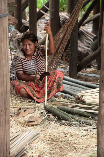 Bamboo Cambodia Day Outdoors Portrait Rural Scene Seated Woman Village Woman Portrait Woman Working Wood - Material Wood Working