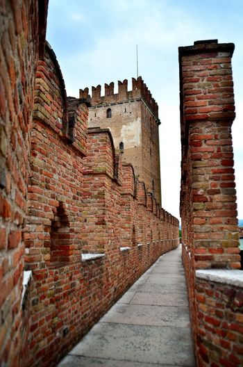 View of Castelvecchio Castle, Verona Castelvecchio Verona Verona Ancient Architecture Art Brick Brick Wall Building Building Exterior Built Structure Day Direction Fort Fortified Wall History Italy No People Old Outdoors Sky The Past Travel Travel Destinations Wall Wall - Building Feature