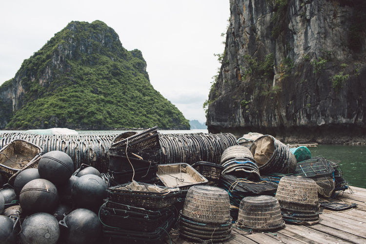 Baskets And Buoys On Pier At Halong Bay