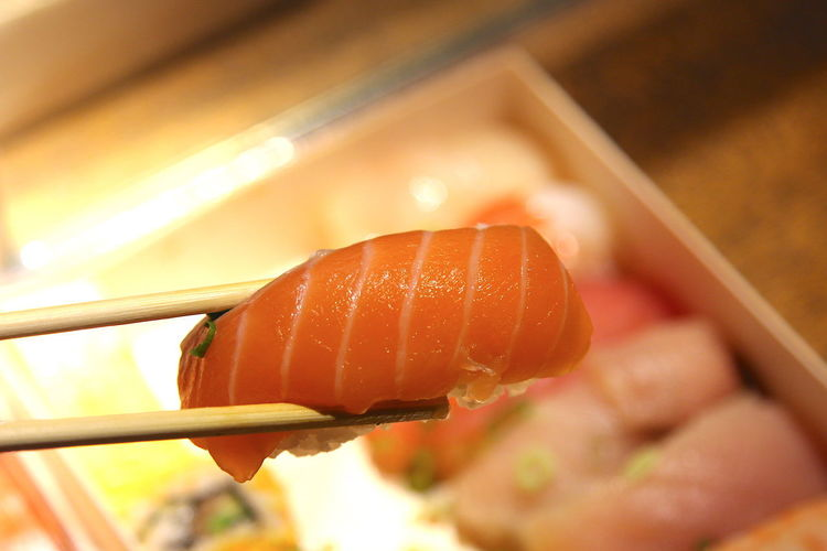 Close-up of a hand holding sushi