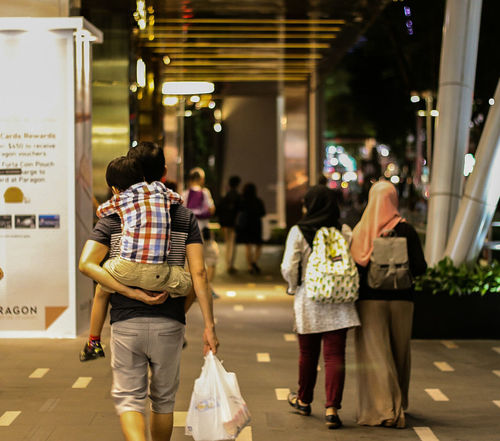 Father and son. Singapore Bright Fine Art Photography Singapore City 43 Golden Moments Childhood Childhood Memories Family Father & Son Piggyback Bonding Orchard Road Orchard Road_singapore City Life Family Time People Photography People People Together People Together People Together By August 3 2016