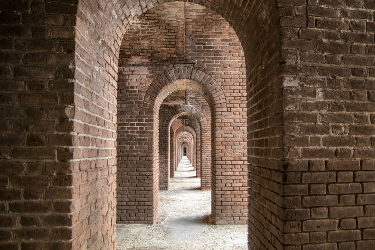 Long hallway at Fort Jefferson Civil War Fort in the Dry Tortugas. Civil War Arch Architecture Brick Brick Wall Built Structure Castle Civil War History Day Florida Florida Keys Fort History Long Hallway No People Old Ruin Red Brick Stone