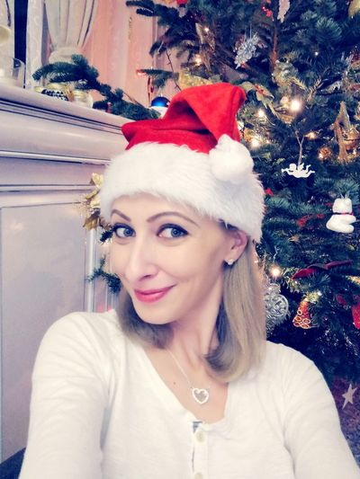 Christmas Tree Christmas Lights Christmas Time Self Portrait Selfie ✌ Beautiful Woman Santa's Little Helper Christmas Christmas Tree Holiday - Event Portrait Indoors  Christmas Decoration Only Women Smiling One Woman Only Looking At Camera Happiness Home Interior Santa Hat Cheerful Celebration