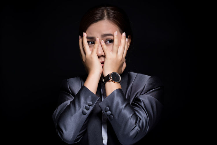 Businesswoman feel scared on isolated black background Black Background Portrait Surprised Woman Shocked Emotion Emotional Emotional Stress Amazed Excited Black Black Background Dark Suit Business Businesswoman Isolated Grief Sorrow Sad Sadness Pain Problem Trouble Hurt