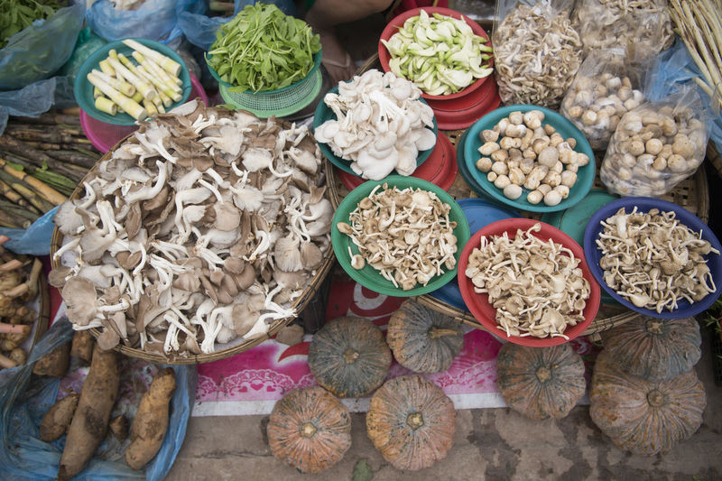 High angle view of various dried mushrooms and vegetables at market stall