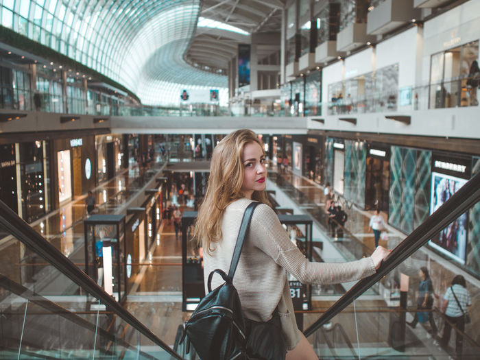 Adult Adults Only Blond Hair Caucasian City Cityscape Day Going Down Happiness Happy Indoors  Journey Looking Back One Person People Portrait Of A Woman Portraits Retail  Smiling Store Travel Urban Woman Women Women Who Inspire You